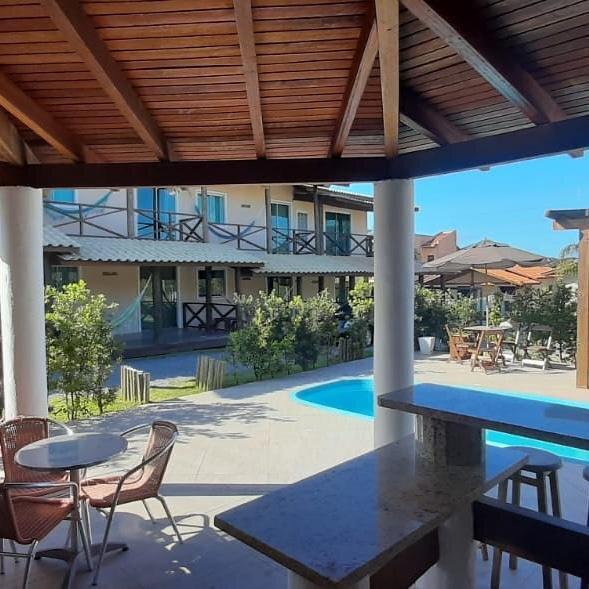 Pousada bem localizada, com aptos completos na Praia do Rosa / SC, alquiler de vacaciones en Ibiraquera