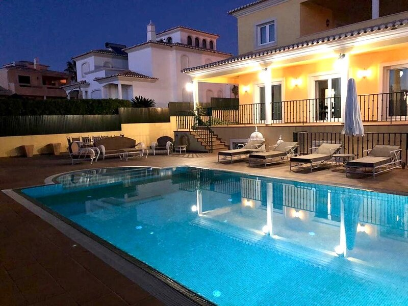 Swimming pool area by night