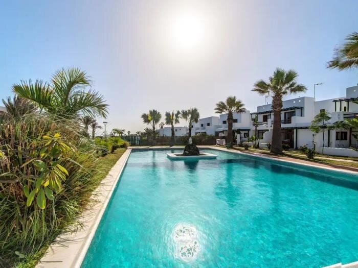 Duplex B16 in a quiet complex with a pool, 150m from the sea, alquiler de vacaciones en Charco del Palo