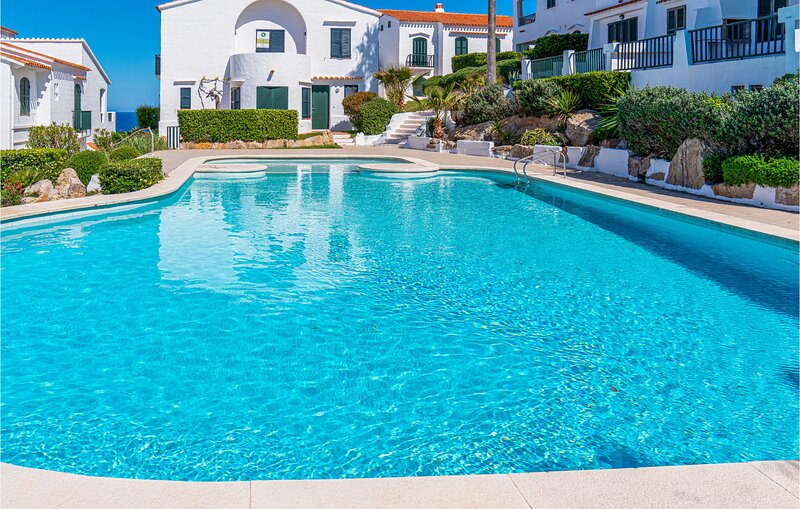 Beautiful apartment in Menorca with Outdoor swimming pool, WiFi and 2 Bedrooms (, holiday rental in Fornells