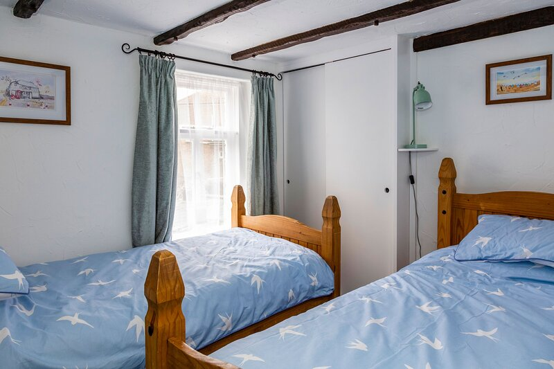 Bright and cosy twin bedroom with ample storage space,