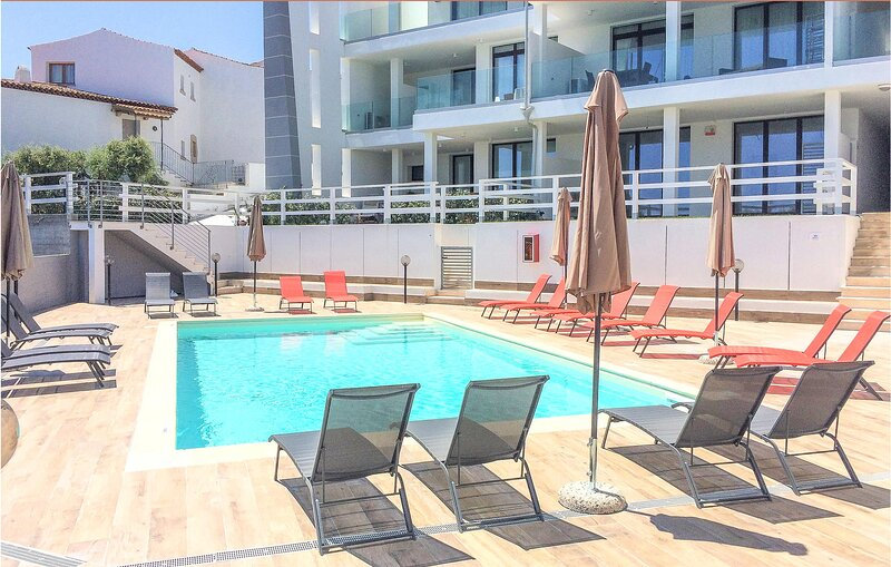 Amazing apartment in Cannigione with Outdoor swimming pool, WiFi and 1 Bedrooms, holiday rental in Cannigione