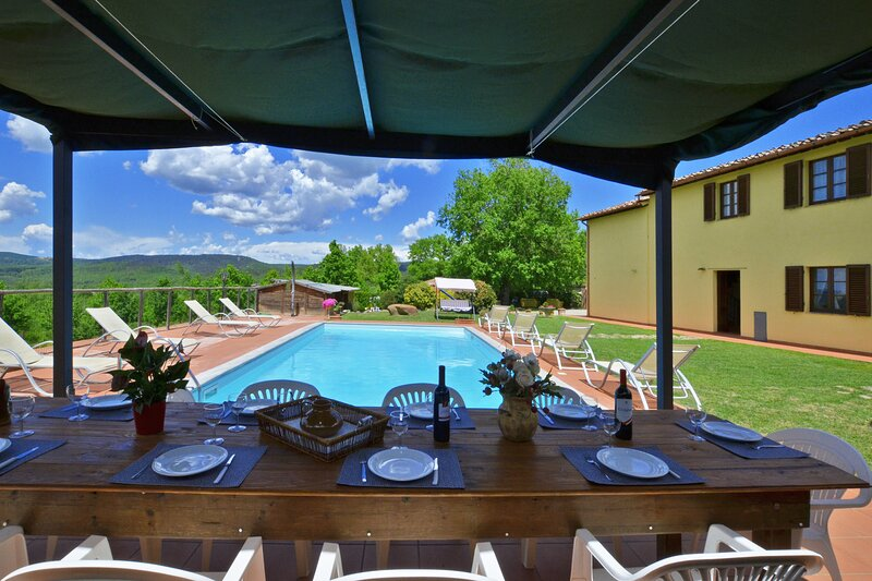 The property and  equipped pergola for dinner close the pool