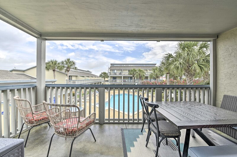 Private Balcony | Outdoor Dining Table | Seating | Community Pool View