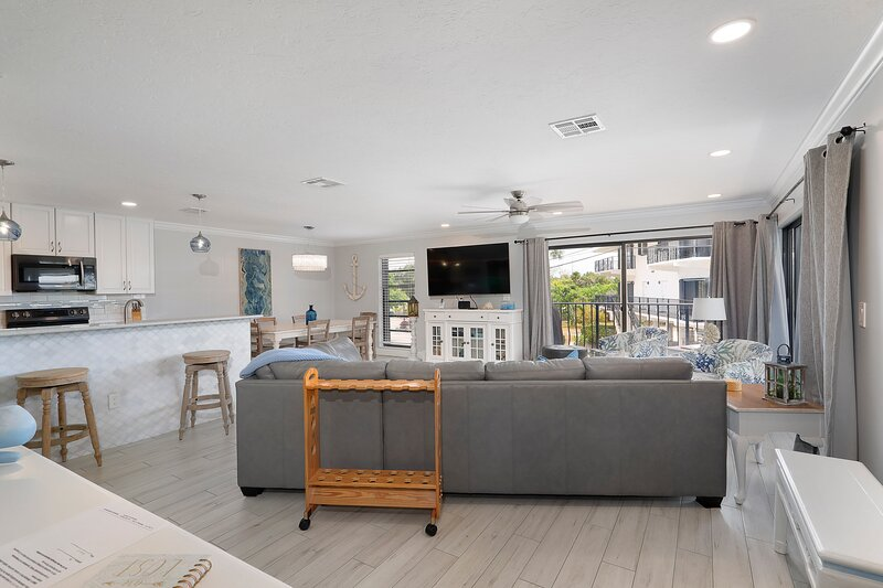 Spacious living area with lots of seating and a large screen TV