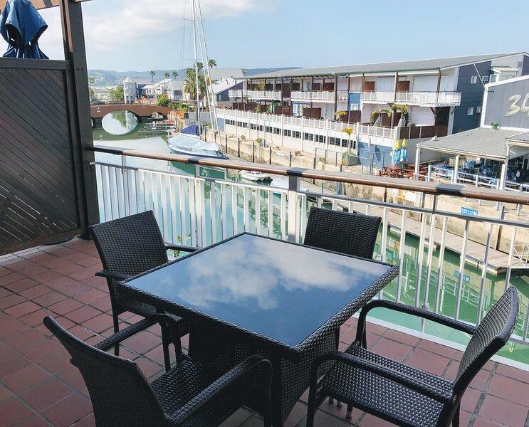 Shaun's Waterfront Apartment ♥ Patio with Marina Views | WIFI | Braai, holiday rental in Brenton-on-Sea