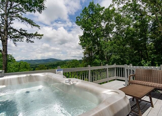 Soak in the luxurious hot tub with a glass of wine