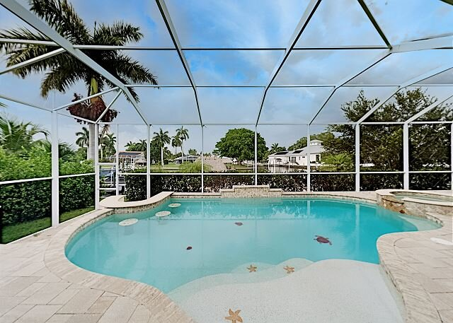 Luxe Waterfront Escape   Heated Pool, Hot Tub, Gulf Access   Stroll to Beach, vacation rental in Cape Coral