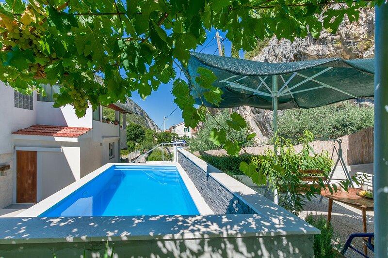 House Melita, location de vacances à Podaspilje