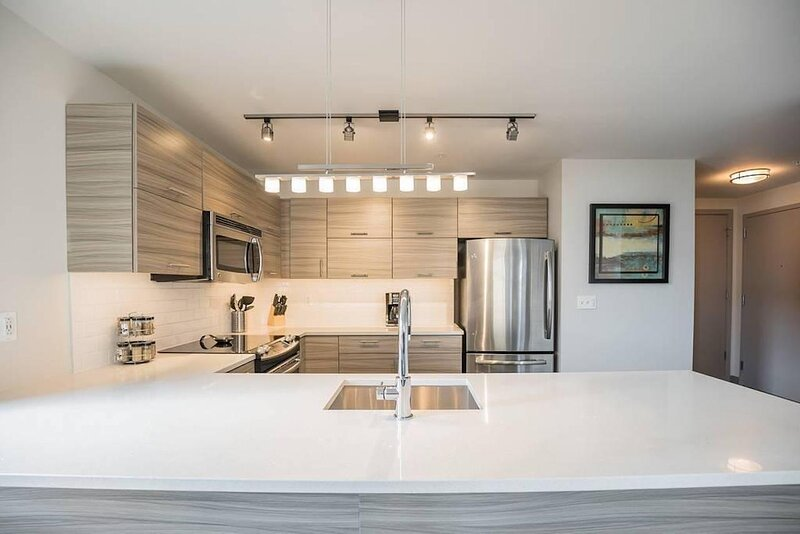 Modern, spacious 2 bedroom 2 bathroom home located steps from the Avenue of the Arts.  Thishome is a beautiful corner unit, allowing plenty of light in.  Also offered for extra guests is a sleeper sofa in the living room. The location couldn't be be...