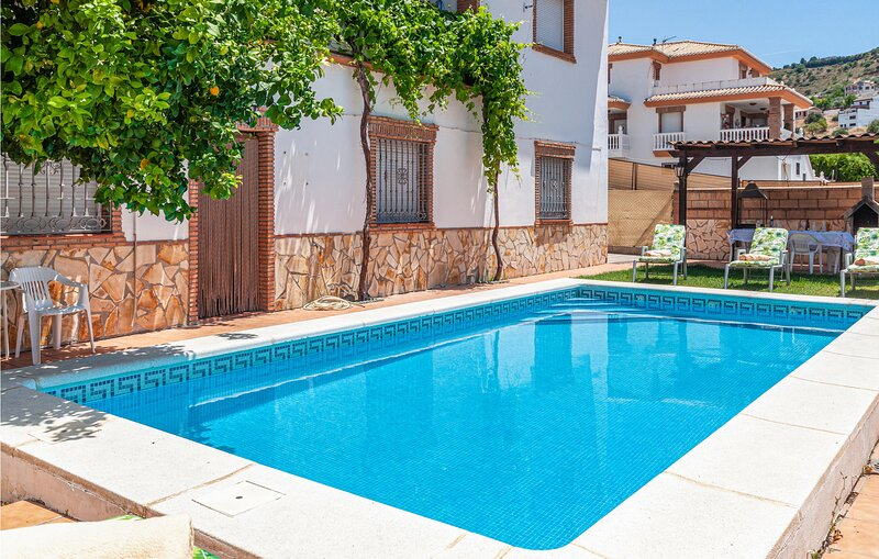 Awesome home in Montefrio with Outdoor swimming pool, WiFi and 3 Bedrooms (EAC55, holiday rental in Huetor Tajar