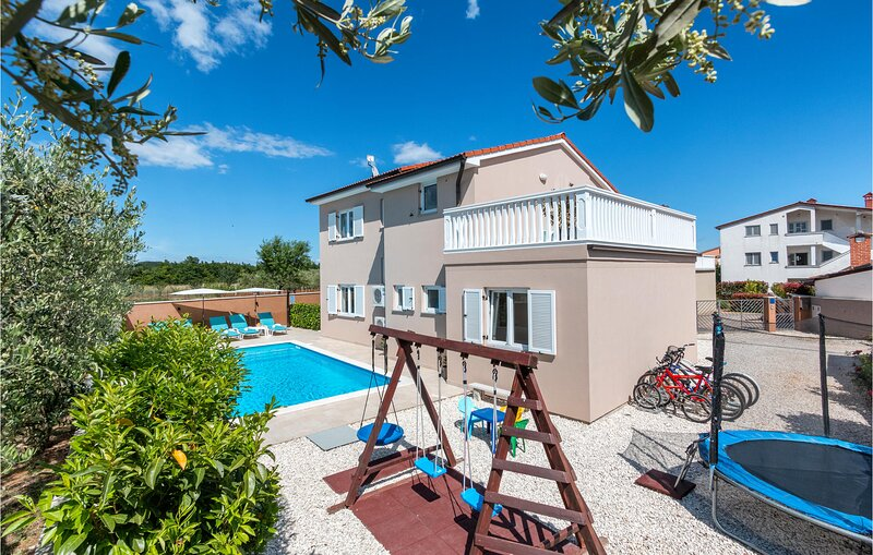 Awesome home in Loborika with WiFi and 3 Bedrooms (CIC186), holiday rental in Loborika