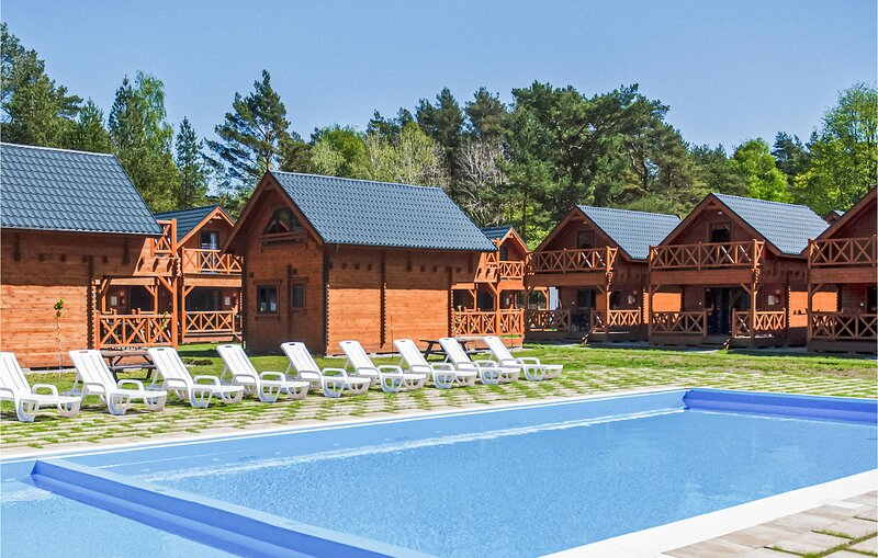 Stunning home in Mrzezyno with Outdoor swimming pool, WiFi and 2 Bedrooms (PPO78, holiday rental in Grzybowo