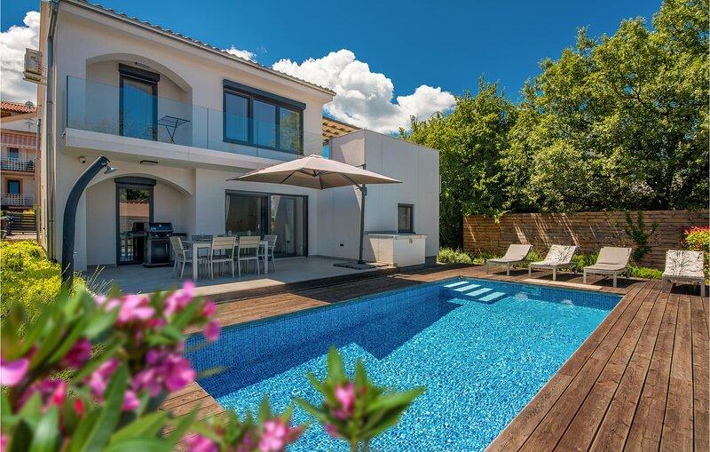 Stunning home in Malinska with Outdoor swimming pool, WiFi and 3 Bedrooms (CKI10, vacation rental in Zidarici