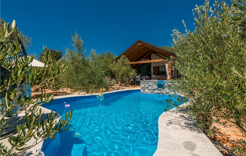 Nice home in Punat with Outdoor swimming pool and 2 Bedrooms (CKI108), holiday rental in Kornic