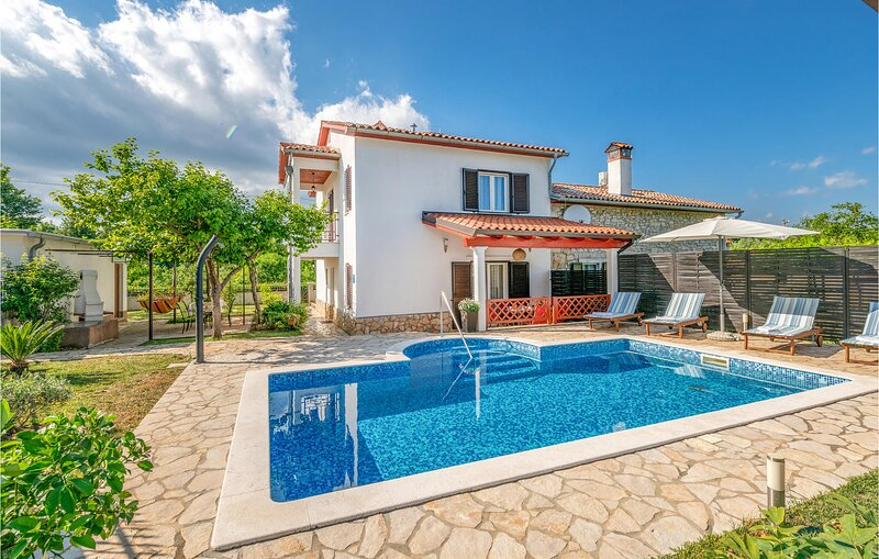 Awesome home in Labin with Outdoor swimming pool, WiFi and 3 Bedrooms (CIK805), holiday rental in Kunj