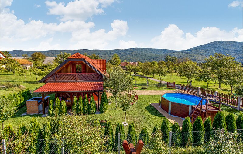 Awesome home in Licko Lesce with WiFi, Outdoor swimming pool and 1 Bedrooms (CKB, holiday rental in Lički Osik