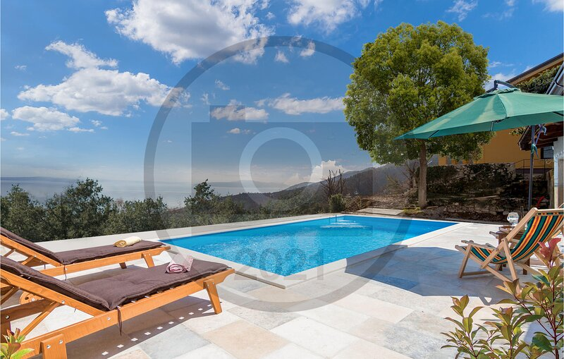 Nice home in Poljane with Outdoor swimming pool and 4 Bedrooms (CKO055), holiday rental in Vranja