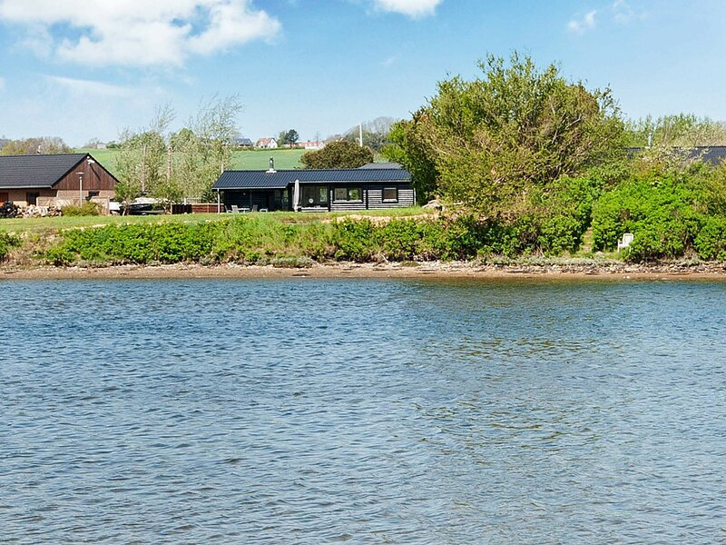 Waterfront Holiday Home in Norsminde with Terrace, holiday rental in Harlev