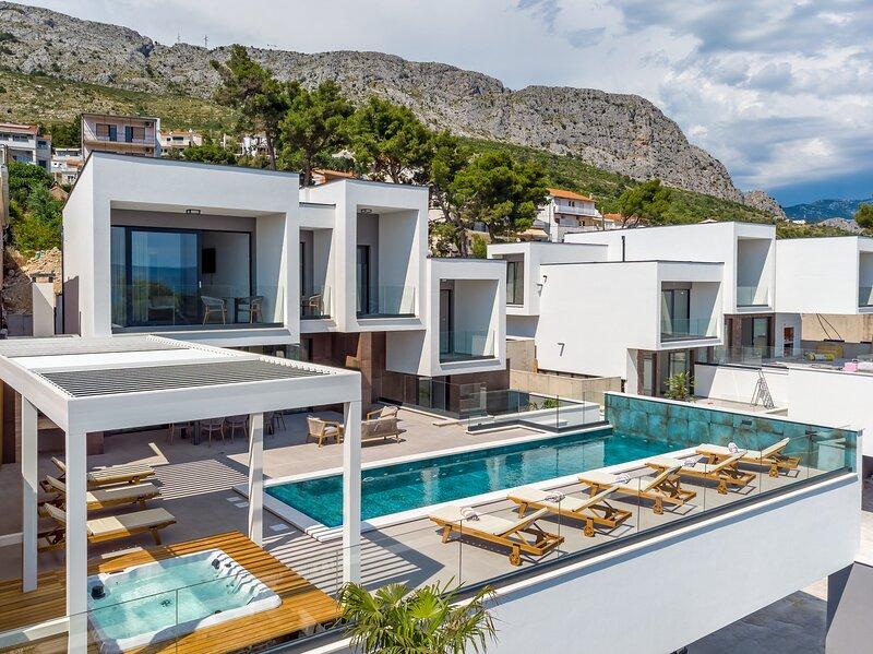 Brand new Villa Largo with 4 en-suite bedrooms, heated 33 sqm pool, sea views, aluguéis de temporada em Dugi Rat