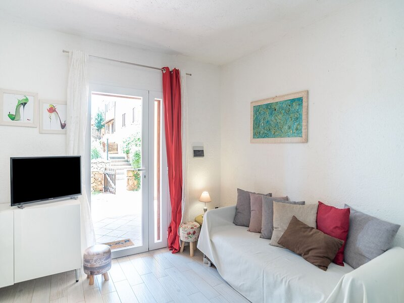 Attractive Holiday Home in Marinella with Patio, holiday rental in Marinella