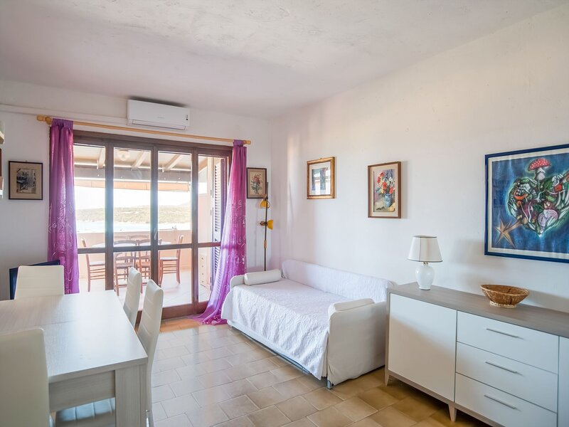 Lovely Holiday Home in Marinella with Terrace, holiday rental in Marinella
