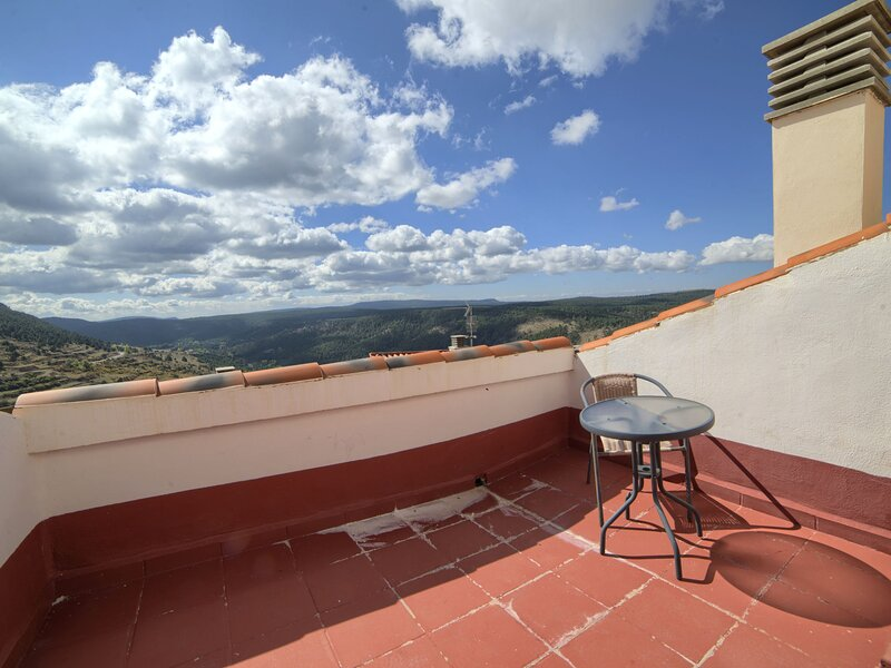 Pleasant Apartment in Gudar with Fireplace, holiday rental in Aliaga
