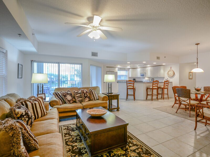 """Tastefully decorated living room with Tommy Bahama style decor, 60"""" flat screen HDTV and DVD."""