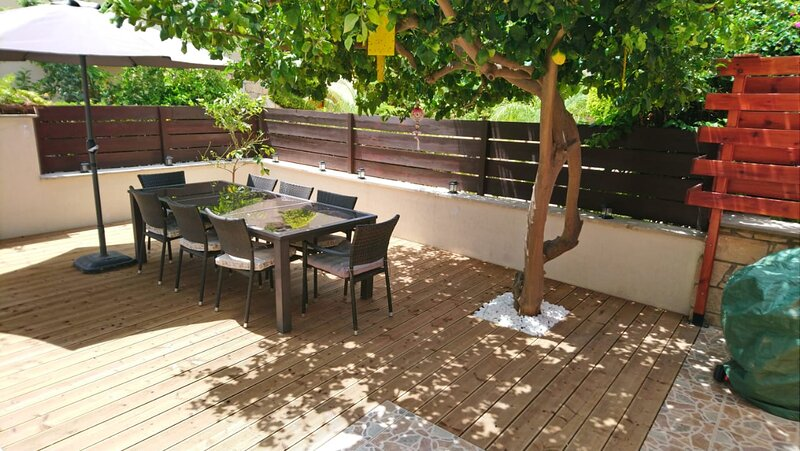Outside dining under the cool shade of the lemon tree (and a large umbrella!!)
