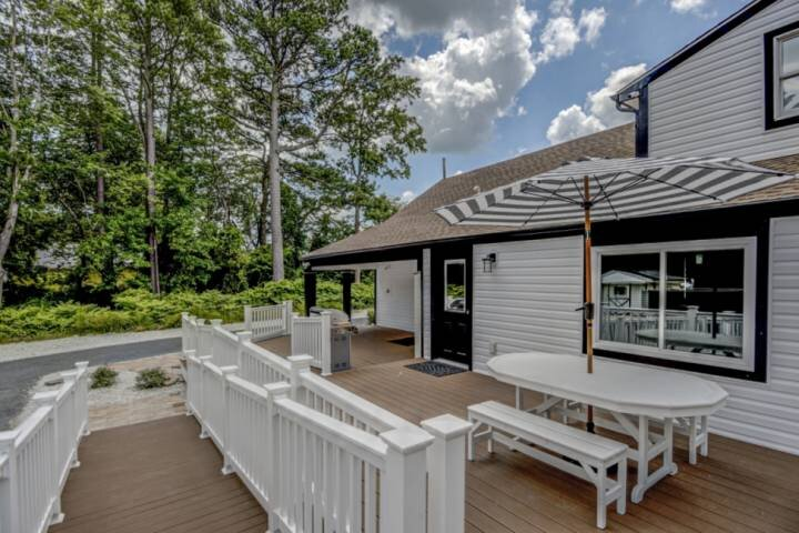 Large ADA-Compliant Deck | Table with Umbrella, Gas Grill, Beach Gear Cabinet, and Outdoor Shower