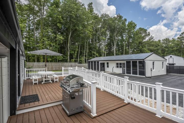 View 2 | Large ADA-Compliant Deck | Table with Umbrella, Gas Grill, Beach Gear Cabinet, and Outdoor Shower