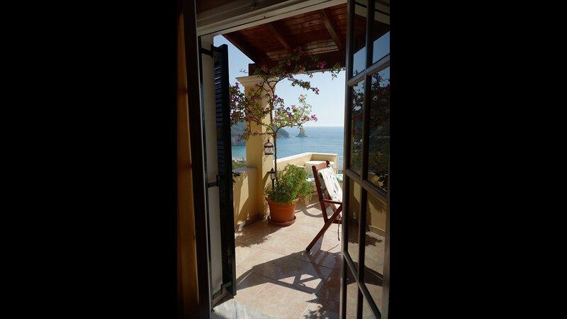 Natalia Loft Apartment C with panoramic sea views of Agios Gordios bay, holiday rental in Ano Garouna