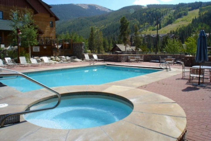 Take In The Rocky Mountain View While Swimming And Relaxing In The Hot Tub
