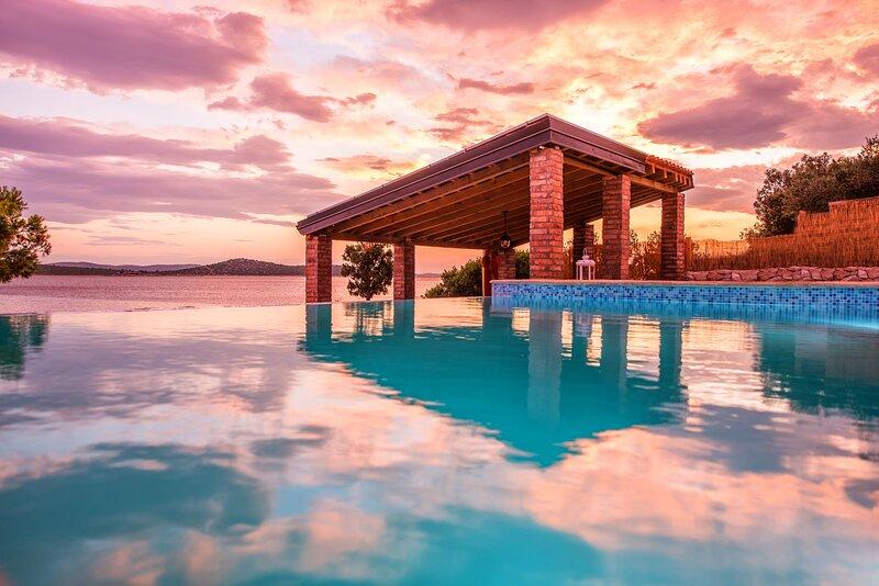Poolincluded Beachfront Villa Little Sea House, holiday rental in Tkon