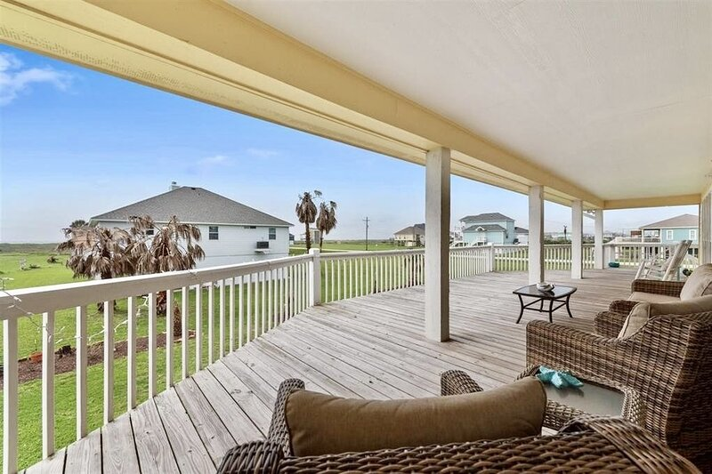 Balcony,Couch,Furniture,Porch,Railing
