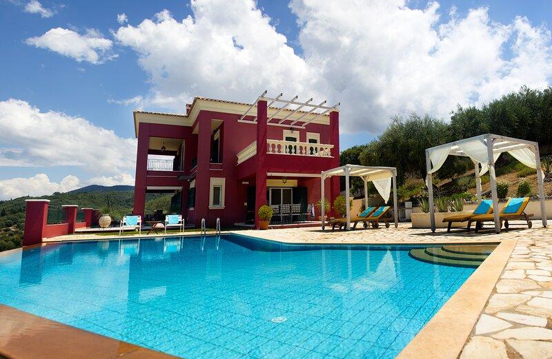 Stylish villa Regina Rossa with unique sea views among olive trees!, location de vacances à Acharavi