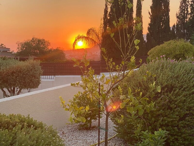sunset at the front of house