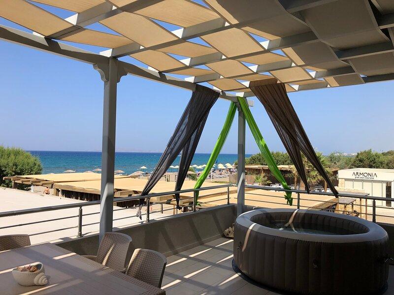 Ammos Beachfront Luxury Apartment, holiday rental in Ammoudara