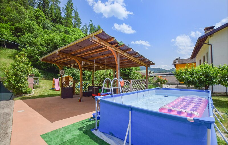 Beautiful home in Sovramonte with WiFi, Outdoor swimming pool and 2 Bedrooms (ID, holiday rental in Tonadico