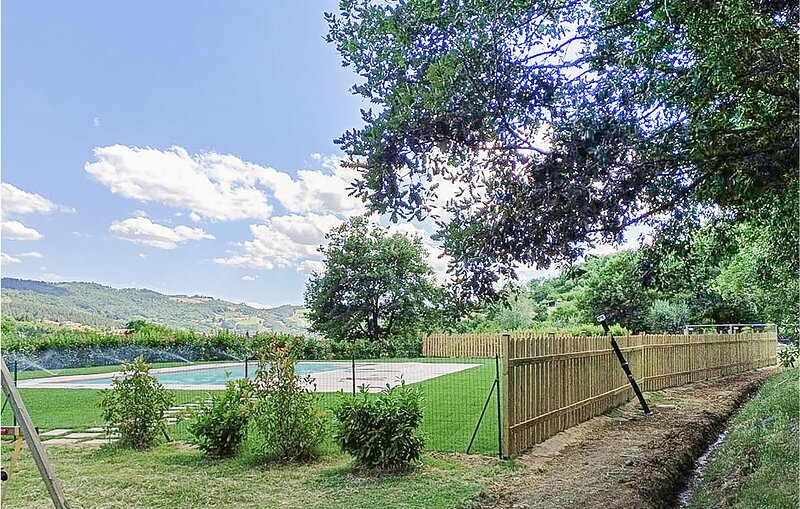 Nice home in Capolona with Outdoor swimming pool, WiFi and 8 Bedrooms (ITA071), holiday rental in Bibbiano