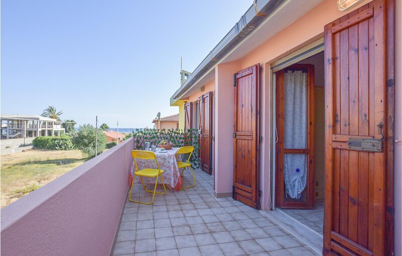 Awesome apartment in Solanas with 2 Bedrooms (IGC108), location de vacances à Solanas