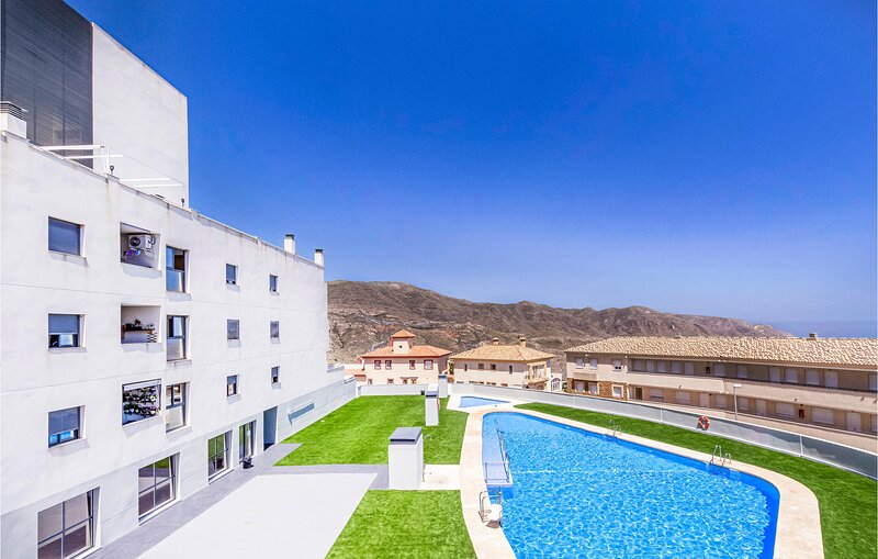 Nice apartment in La envia with Outdoor swimming pool, WiFi and 2 Bedrooms (EAM1, alquiler vacacional en Rágol