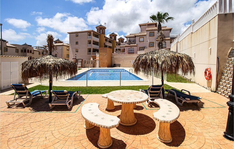 Stunning apartment in Orihuela Costa with Outdoor swimming pool, WiFi and 2 Bedr, holiday rental in Los Dolses