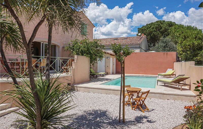 Awesome home in Creissan with Outdoor swimming pool, Heated swimming pool and 5, holiday rental in Creissan