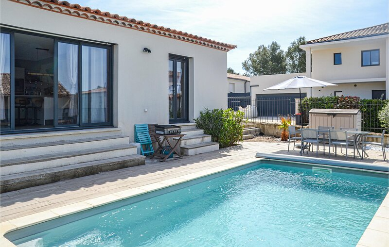 Amazing home in Beaulieu with Outdoor swimming pool, WiFi and 3 Bedrooms (FLH507, casa vacanza a Restinclieres