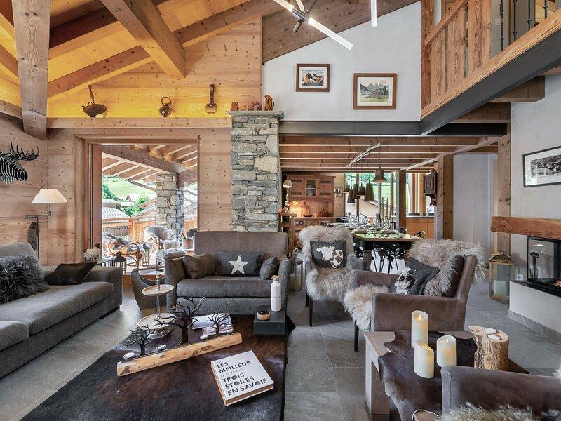 Charmant appartement contemporain avec des matériaux nobles, location de vacances à Le Bettaix