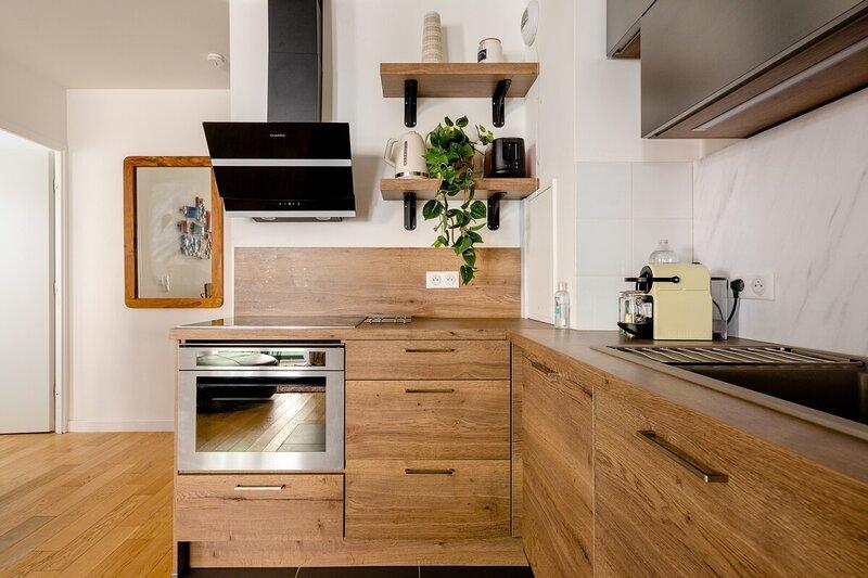 Lesapparts Paris-Clichy 3p neuf wifi gratuit et cuisine et terrasse équipée park, holiday rental in Gennevilliers