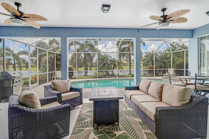 Experience the best of lanai living in this home's beautiful outdoor space - complete with fire table, pool and spa.