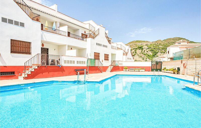 Stunning apartment in Granada with Outdoor swimming pool, WiFi and 2 Bedrooms (E, holiday rental in Velez de Benaudalla