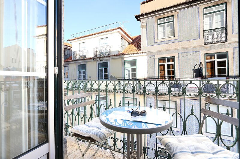 A beautiful apartment in the historic centre, with a balcony overlooking downtown